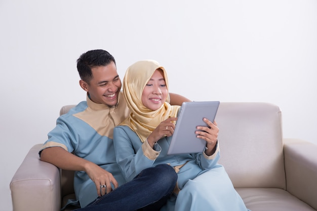 Asian muslim couple using tablet