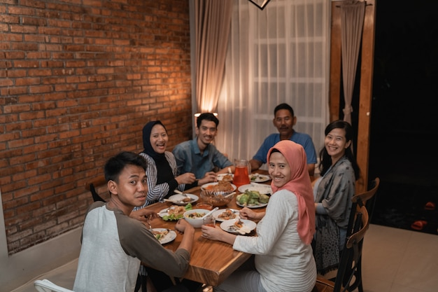 Asian muslim family dinner together. break fasting