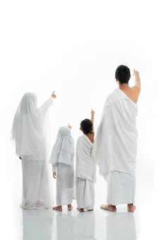 Asian muslim family hajj shot from behind