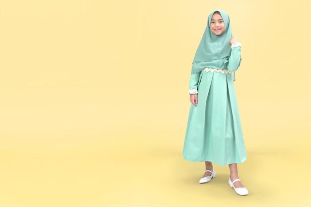 Asian muslim girl in tosca dress
