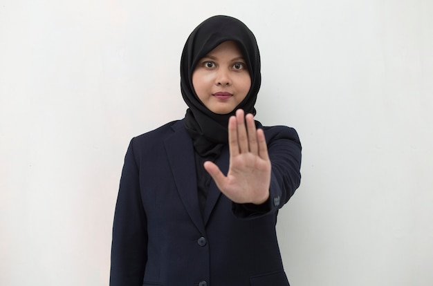 Asian muslim hijab woman show stop hands gesture