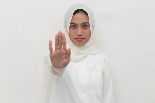 Asian muslim hijab woman show stop hands gesture