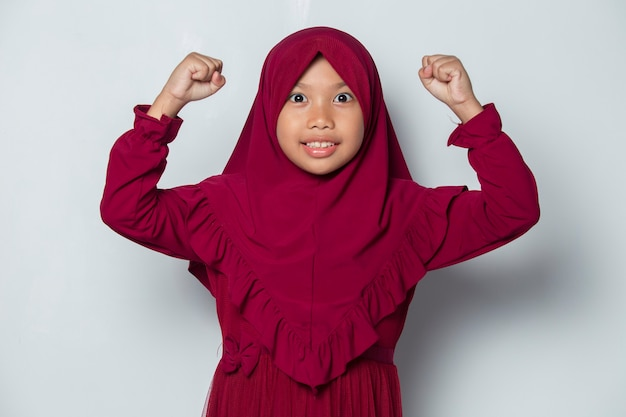 Asian muslim little girl happy and excited celebrating victory expressing big success