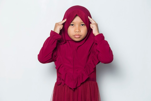 Asian muslim  little girl thinks idea isolated on white background