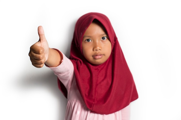 Asian muslim little girl on a white background