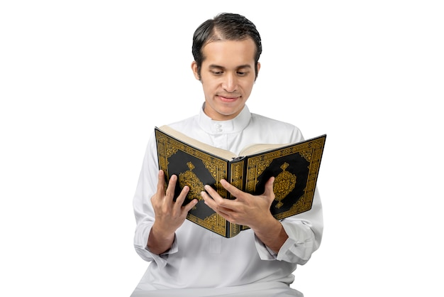 Asian muslim man reading the quran