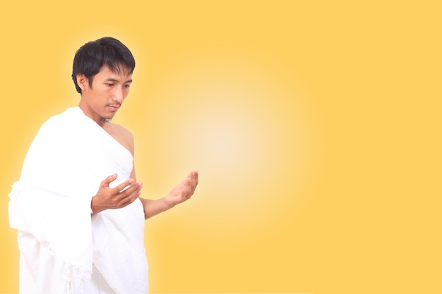 Asian muslim man wearing ihram clothes