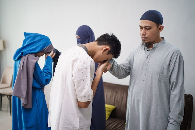 Asian muslim parent shake hand in idul fitri eid mubarak