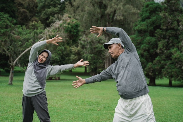 Asian muslim senior couple exercising together
