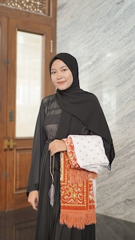 Asian muslim woman after worship at the mosque