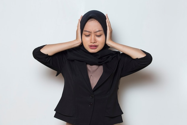 Asian muslim woman a covers her ears