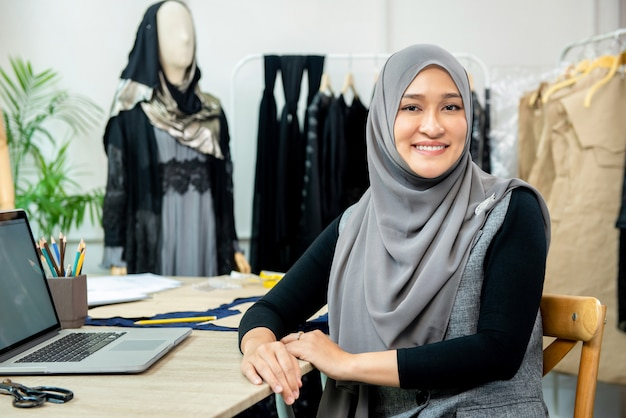 Asian muslim woman designer in her tailor shop