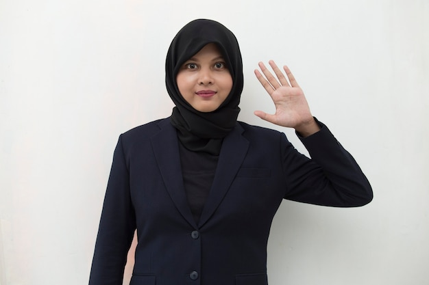 Asian muslim woman greeting with hand gesture