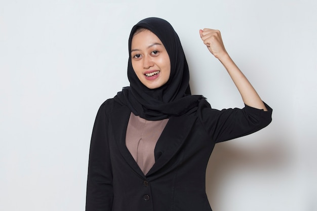 Asian muslim woman happy and excited celebrating victory expressing big success