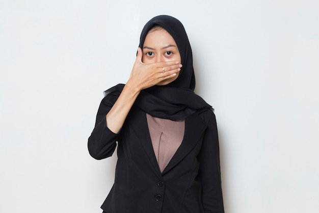 Asian muslim woman put her hand cover her mouth