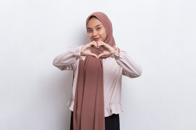 Asian muslim woman showing heart sign love isolated on white background