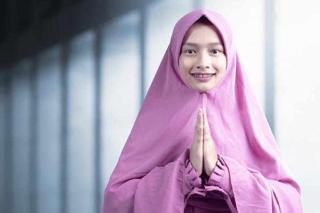 Asian muslim woman in veil praying