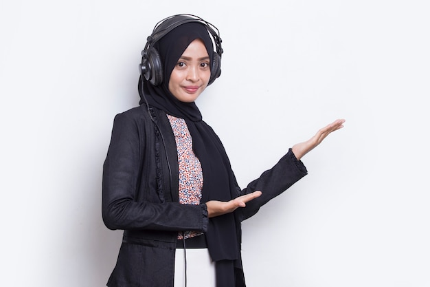 Asian muslim woman wearing hijab operator customer service pointing with fingers to directions