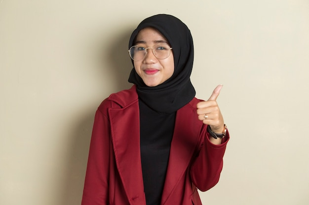 Asian muslim woman wearing hijab with glasses making ok sign with hand gesture