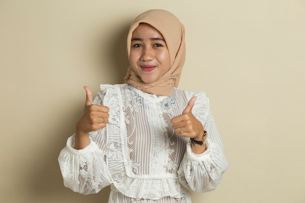 Asian muslim woman wearing hijab with ok sign gesture