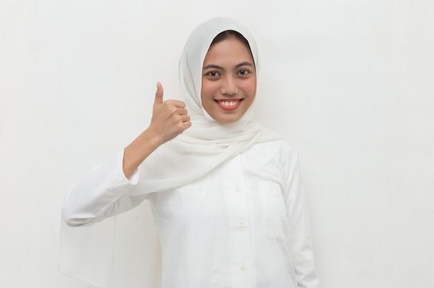 Asian muslim woman wearing hijab with ok sign gesture Premium Photo