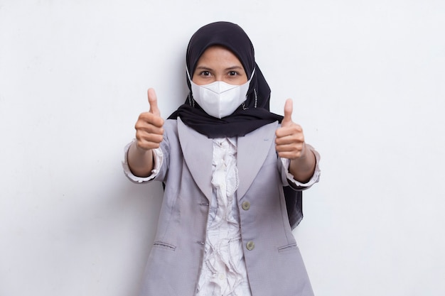 Asian muslim woman wearing medical face mask to protection corona virus covid19 posing on white