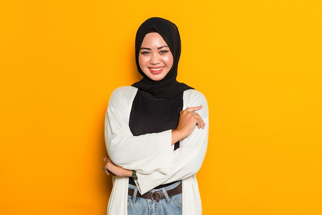Asian muslim woman with folded arms