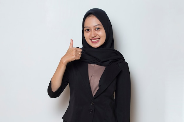 Asian muslim woman with hand thumbs up ok sign gesture
