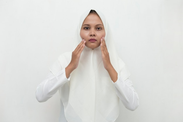 Asian muslim woman with toothache portrait of woman suffering from toothache pain, tooth decay, tooth sensitivity