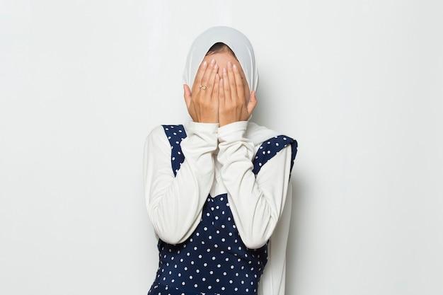 Asian muslim women hands covering face