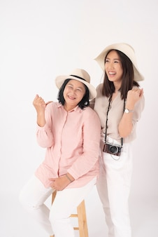 Asian older woman and her daughter  , travel concept