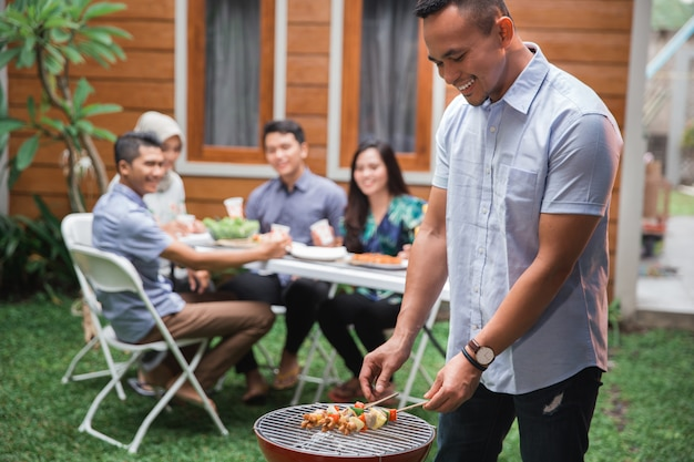 Asian people barbecue with friends