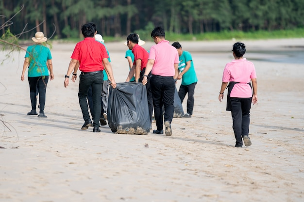 A asian people cleaning white sand beach