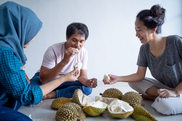 Asian people eating durian