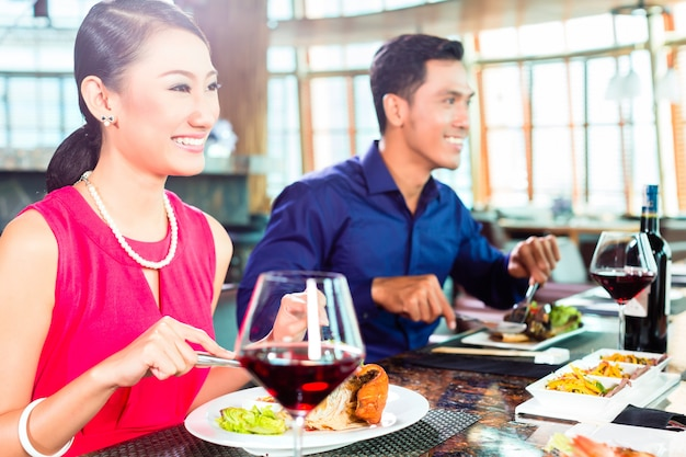Asian people fine dining in restaurant