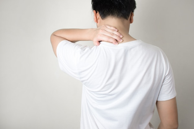 Asian people have neck pain from work.