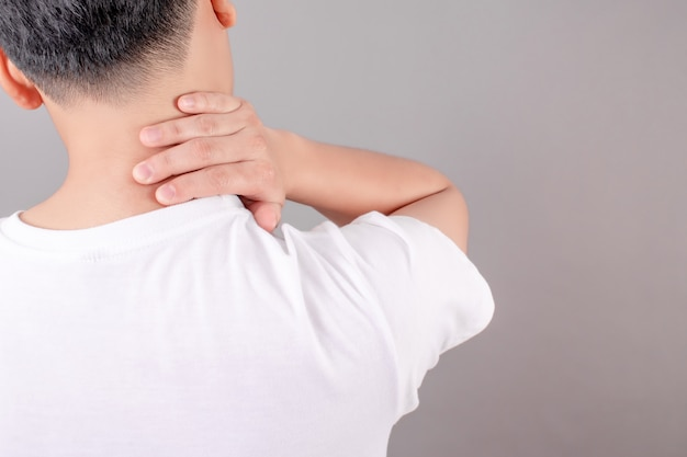 Asian people wear white shirts, feel tired and suffer from neck pain. health concept