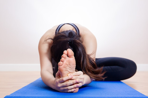 Asian pretty girl doing stretching close up.