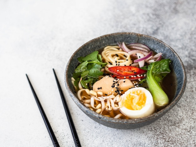 Asian ramen noodles with chicken, pak choi cabbage and egg