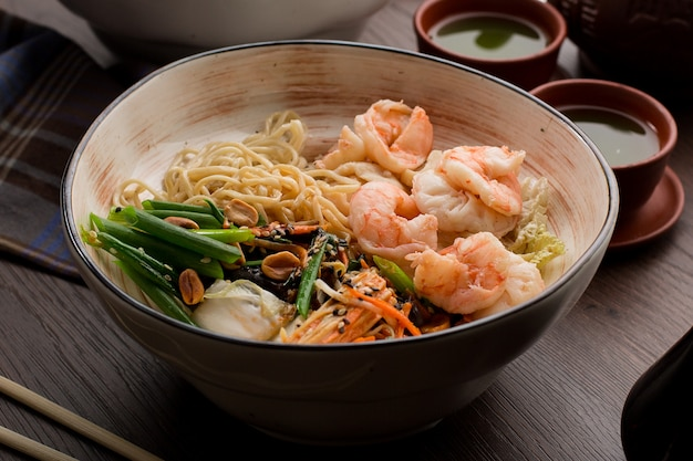 Asian ramen with shrimps and noodles in a restaurant