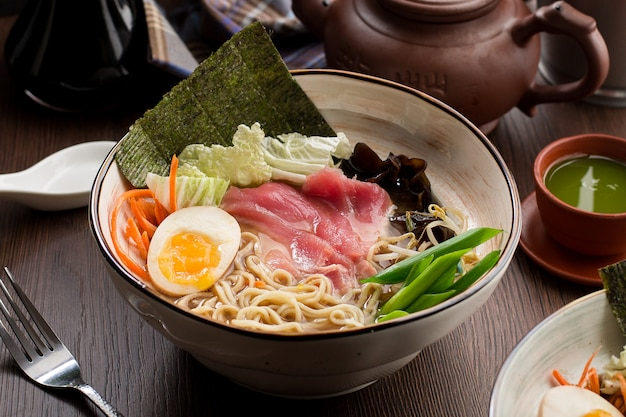 Asian ramen with tuna and noodles in a restaurant