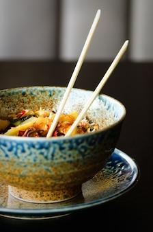 Asian rice with pork, mu-err mushrooms, napa cabbage, pickled bamboo shoots, spinach, teriyaki