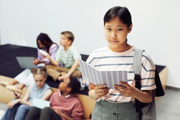 Asian schoolgirl looking at camera