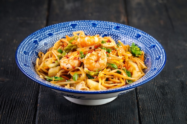 Asian seafood udon noodles in a traditional bowl