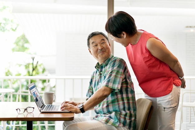 Asian senior couple at home