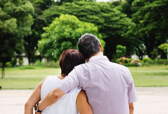 Asian senior couple in the park rear view free image