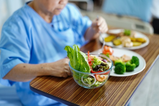 Asian senior or elderly old lady woman patient eating breakfast healthy food