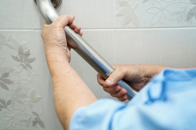 Asian senior or elderly old lady woman patient use toilet