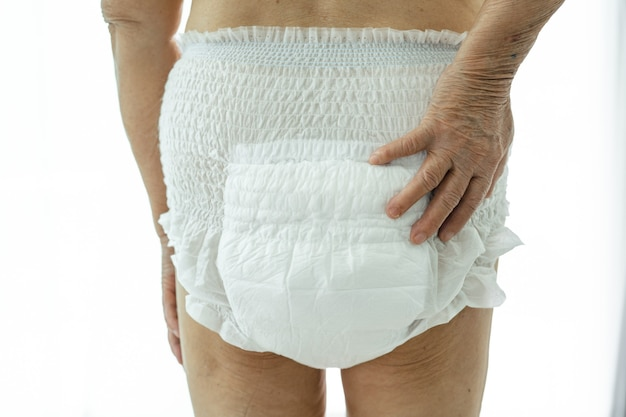 Asian senior or elderly old lady woman patient wearing incontinence diaper