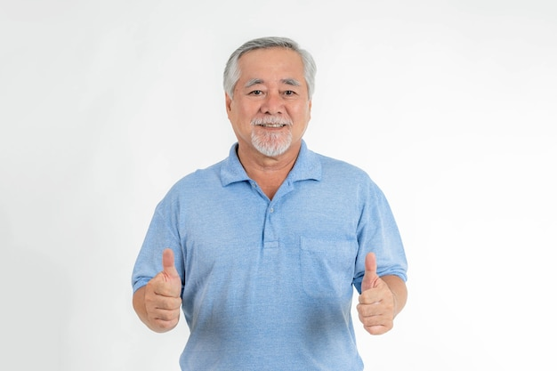 Asian senior man , old man giving a thumb up feel happy good health on white background - lifestyle senior success in business or in personal life concept